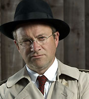 Dirk Gently's Holistic Detective Agency. Dirk Gently (Harry Enfield). Image credit: Above The Title Productions.