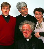 Father Ted. Image shows from L to R: Father Dougal McGuire (Ardal O'Hanlon), Father Ted Crilly (Dermot Morgan), Father Jack Hackett (Frank Kelly), Mrs Doyle (Pauline McLynn). Image credit: Hat Trick Productions.