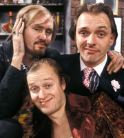 Filthy Rich & Catflap. Image shows from L to R: Ralph Filthy (Nigel Planer), Eddie Catflap (Adrian Edmondson), Richie Rich (Rik Mayall). Image credit: British Broadcasting Corporation.