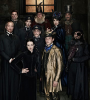 Terry Pratchett's Going Postal. Image shows from L to R: Lord Vetinari (Charles Dance), Rufus Drumknott (Steve Pemberton), Stanley Howler (Ian Bonar), Adora Belle Dearheart (Claire Foy), Mustrum Ridcully (Timothy West), Tolliver Groat (Andrew Sachs), Moist Von Lipwig (Richard Coyle), Sachrissa Cripslock (Tamsin Greig), Crispin Horsefly (Madhav Sharma), Reacher Gilt (David Suchet). Image credit: The Mob Film Co.