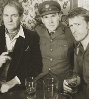 Hut 33. Image shows from L to R: Charles (Robert Bathurst), Joshua Fanshawe-Marshall (Alex Macqueen), Archie (Tom Goodman-Hill). Image credit: British Broadcasting Corporation.