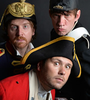 John Finnemore's Souvenir Programme. Image shows from L to R: Simon Kane, John Finnemore, Lawry Lewin. Image credit: British Broadcasting Corporation.