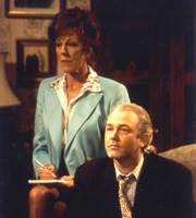 The Legacy Of Reginald Perrin. Image shows from L to R: Joan Greengross (Sue Nicholls), Hank Millbeck (Michael Fenton Stevens).