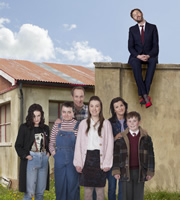 Moone Boy. Image shows from L to R: Trisha (Aoife Duffin), Sinead (Sarah White), Liam (Peter McDonald), Fidelma (Clare Monnelly), Debra (Deirdre O'Kane), Martin (David Rawle), Chris O'Dowd. Copyright: Baby Cow Productions / Sprout Pictures.