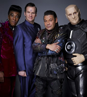 Red Dwarf. Image shows from L to R: Cat (Danny John-Jules), Rimmer (Chris Barrie), Lister (Craig Charles), Kryten (Robert Llewellyn). Image credit: Grant Naylor Productions.