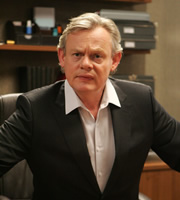 Reggie Perrin. Reggie Perrin (Martin Clunes). Image credit: Objective Productions.