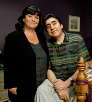Roger & Val Have Just Got In. Image shows from L to R: Val Stevenson (Dawn French), Roger Stevenson (Alfred Molina). Image credit: British Broadcasting Corporation.