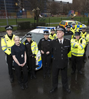 Scot Squad. Image shows from L to R: PC Charlie McIntosh (Chris Forbes), Maggie LeBeau (ML Stone), PC Jane Mackay (Ashley Smith), Sergeant Karen Ann Millar (Karen Bartke), PC Sarah Fletcher (Sally Reid), Chief Commissioner Cameron Miekelson (Jack Docherty), PC Jack McLaren (Jordan Young), PC Hugh McKirdy (Grado), Volunteer Officer Ken Beattie (James Allenby-Kirk), PC Surjit Singh (Manjot Sumal). Image credit: The Comedy Unit.
