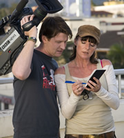 Taking The Flak. Image shows from L to R: Rory Wallace (Damian O'Hare), Jane Thomason (Doon Mackichan). Copyright: BBC.
