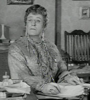 The Belles Of St. Trinian's. Miss Millicent Fritton (Alastair Sim). Image credit: London Films.
