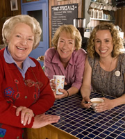 The Café. Image shows from L to R: Mary Ellis (June Watson), Carol Porter (Ellie Haddington), Sarah Porter (Michelle Terry). Image credit: Jellylegs.