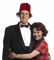 Tommy Cooper: Not Like That, Like This. Image shows from L to R: Tommy Cooper (David Threlfall), Mary Kay (Helen McCrory). Image credit: Left Bank Pictures.