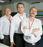 Twenty Twelve. Image shows from L to R: Nick Jowett (Vincent Franklin), Ian Fletcher (Hugh Bonneville), Graham Hitchins (Karl Theobald). Image credit: British Broadcasting Corporation.