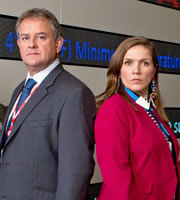 W1A. Image shows from L to R: Ian Fletcher (Hugh Bonneville), Siobhan Sharpe (Jessica Hynes). Image credit: British Broadcasting Corporation.