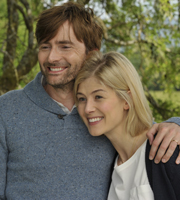 What We Did On Our Holiday. Image shows from L to R: Doug McLeod (David Tennant), Abi McLeod (Rosamund Pike). Image credit: Origin Pictures.