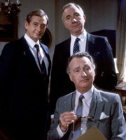 Yes, Prime Minister. Image shows from L to R: Bernard Woolley (Derek Fowlds), Sir Humphrey Appleby (Nigel Hawthorne), James Hacker (Paul Eddington). Image credit: British Broadcasting Corporation.