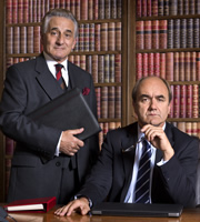 Yes, Prime Minister. Image shows from L to R: Sir Humphrey Appleby (Henry Goodman), Jim Hacker (David Haig). Copyright: BBC.