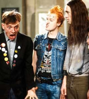 The Young Ones. Image shows from L to R: Rick (Rik Mayall), Vyvyan (Ade Edmondson), Neil (Nigel Planer). Image credit: British Broadcasting Corporation.