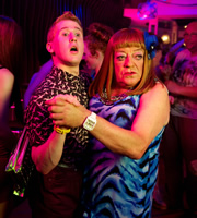 Benidorm. Image shows from L to R: Liam (Adam Gillen), Les / Lesley (Tim Healy). Copyright: Tiger Aspect Productions.