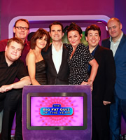 The Big Fat Quiz Of The Year. Image shows from L to R: James Corden, Sean Lock, Claudia Winkleman, Jimmy Carr, Davina McCall, Michael McIntyre, Dara O Briain. Copyright: Hot Sauce / Channel 4 Television Corporation.