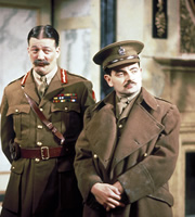 Blackadder. Image shows from L to R: General Melchett (Stephen Fry), Captain Edmund Blackadder (Rowan Atkinson). Copyright: BBC / Tiger Aspect Productions.