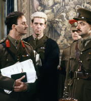 Blackadder. Image shows from L to R: Captain Kevin Darling (Tim McInnerny), Lieutenant George Barleigh (Hugh Laurie), Captain Edmund Blackadder (Rowan Atkinson). Copyright: BBC / Tiger Aspect Productions.