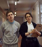 Crims. Image shows from L to R: Luke (Elis James), Dawn (Cariad Lloyd). Copyright: BBC.