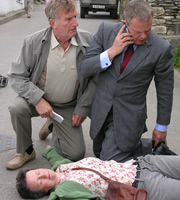 Doc Martin. Image shows from L to R: Clive Tishell (Malcom Storry), Barbara (Georgie Glen), Dr Martin Ellingham (Martin Clunes). Image credit: Buffalo Pictures.