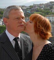 Doc Martin. Image shows from L to R: Dr Martin Ellingham (Martin Clunes), Edith Montgomery (Lia Williams). Copyright: Buffalo Pictures / Homerun Productions.