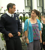 Doc Martin. Image shows from L to R: PC Penhale (John Marquez), Maggie Reid (Julie Graham). Copyright: Buffalo Pictures / Homerun Productions.
