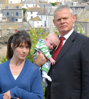 Doc Martin. Image shows from L to R: Louisa Glasson (Caroline Catz), Dr Martin Ellingham (Martin Clunes). Copyright: Buffalo Pictures / Homerun Productions.