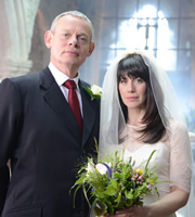 Doc Martin. Image shows from L to R: Dr Martin Ellingham (Martin Clunes), Louisa Glasson (Caroline Catz). Copyright: Buffalo Pictures / Homerun Productions.