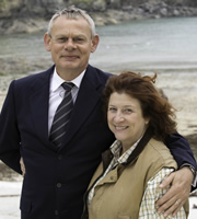 Doc Martin. Image shows from L to R: Dr Martin Ellingham (Martin Clunes), Angela Sim (Caroline Quentin). Copyright: Buffalo Pictures / Homerun Productions.