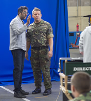 Gary: Tank Commander. Image shows from L to R: Advert Director (Sanjeev Kohli), Gary McLintoch (Greg McHugh). Copyright: The Comedy Unit.