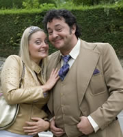 The Green Green Grass. Image shows from L to R: Katia (Morgana Robinson), Bryan (Ivan Kaye). Copyright: Shazam Productions.