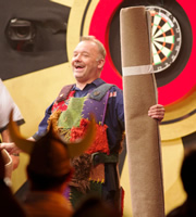 Let's Play Darts For Comic Relief. Bobby 'Carpets' Mortimer. Image credit: Zeppotron.