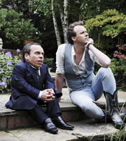 Life's Too Short. Image shows from L to R: Warwick (Warwick Davis), Bryan Medici (Colin Hoult). Copyright: BBC.