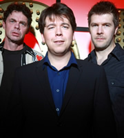 Live At The Apollo. Image shows from L to R: Rich Hall, Michael McIntyre, Rhod Gilbert. Image credit: Open Mike Productions.