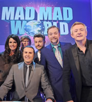 Mad Mad World. Image shows from L to R: Janice Dickinson, Rhys Darby, Paddy McGuinness, Rob Rouse, Rufus Hound, Louis Walsh. Copyright: Roughcut Television.