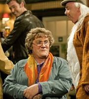 Mrs. Brown's Boys. Image shows from L to R: Agnes Brown (Brendan O'Carroll), Grandad Brown (Dermot O'Neill). Copyright: BBC / BocPix.