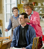 Mrs. Brown's Boys. Image shows from L to R: Winnie McGoogan (Eilish O'Carroll), Trevor Brown (Martin Delany), Agnes Brown (Brendan O'Carroll). Copyright: BBC / BocPix.