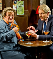 Mrs. Brown's Boys. Image shows from L to R: Agnes Brown (Brendan O'Carroll), William Hunt (Robert Bathurst). Copyright: BBC / BocPix.