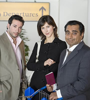 Mumbai Calling. Image shows from L to R: Anthony Harris (Andres Williams), Tiffany Glass (Sophie Hunter), Kenny Gupta (Sanjeev Bhaskar). Copyright: Allan McKeown Presents.