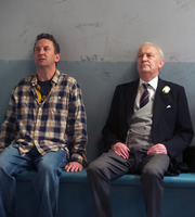 Not Going Out. Image shows from L to R: Lee (Lee Mack), Geoffrey (Geoffrey Whitehead). Image credit: Avalon Television.