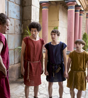 Plebs. Image shows from L to R: Cornelius (Neil Stuke), Stylax (Joel Fry), Marcus (Tom Rosenthal), Grumio (Ryan Sampson). Copyright: RISE Films.
