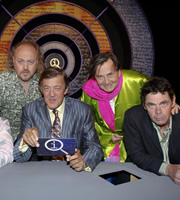 QI. Image shows from L to R: Bill Bailey, Stephen Fry, Barry Humphries, Rich Hall. Image credit: TalkbackThames.