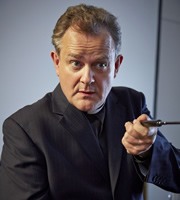 Rev.. Roland Wise (Hugh Bonneville). Copyright: Big Talk Productions.