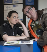 Scot Squad. Image shows from L to R: Sergeant Karen Ann Millar (Karen Bartke), Bobby Muir (Darren Connell). Copyright: The Comedy Unit.