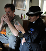 Stella. Image shows from L to R: Dai (Owen Teale), PC Jane Glover (Michelle McTernan). Copyright: Tidy Productions.