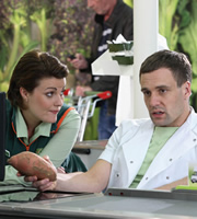 Trollied. Image shows from L to R: Katie (Chanel Cresswell), Kieran (Nick Blood). Copyright: Roughcut Television.
